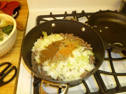 Spices added to beef and onions