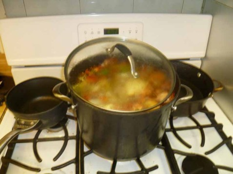 Stock Simmering With Lid On